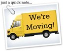"""moving van with with """"We're Moving!"""" written on it."""