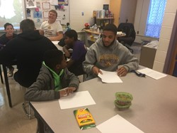 A football player and HMES elementary school student form a special bond.