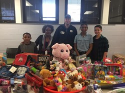 Mykel, Angela, Rich, Jamiona and PJ with their donated toys!