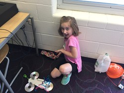 A camper shows off her invention: a high-heel flip flop