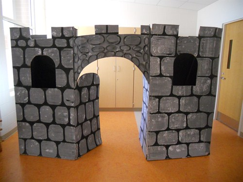 photo of cardboard castle used in Shakepeare play.