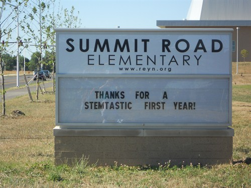 "front street sign following our first year, stating ""thanks for a stemtastic first year!"""