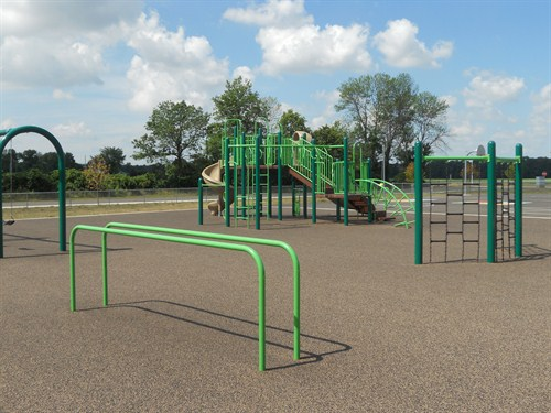 front playground showing equipment for students to play on.