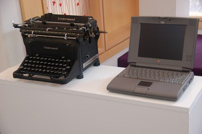photo of old typewriter and laptop.