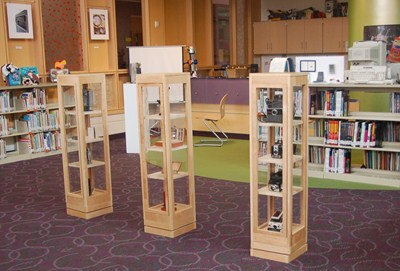 photo of three display cases which were built by our STEM high schools students.