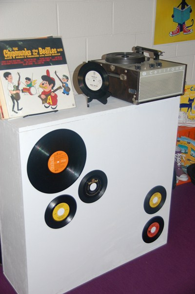 photo of vintage records with record player.