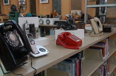photo of display of the many vintage telephones of the past