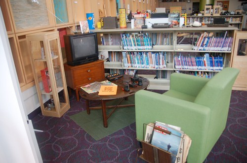photo of chair, television with vintage Atari video game system.