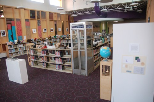 photo of library museum showing an actual telephone booth.