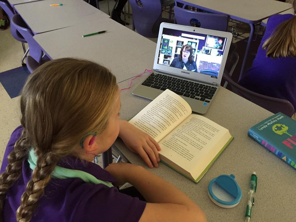 A student reading and learning online