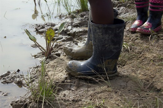 rubber boots in the mud