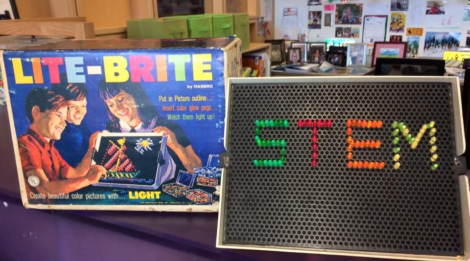photo of vintage lite-brite toy with word STEM created on it.