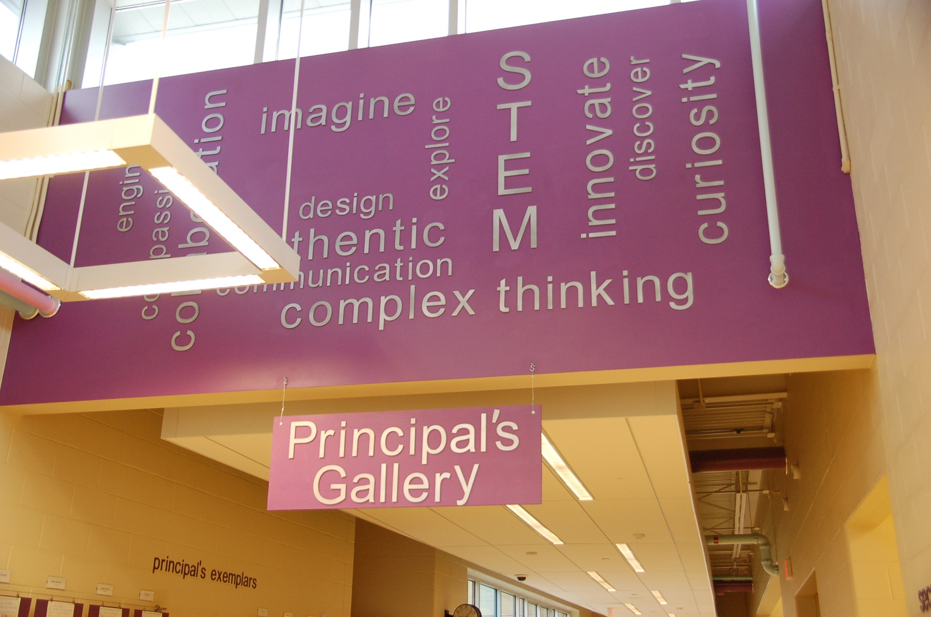 photo of ceiling words posted in principal's gallery.