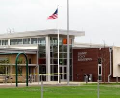 photo of outside at front entrance of school