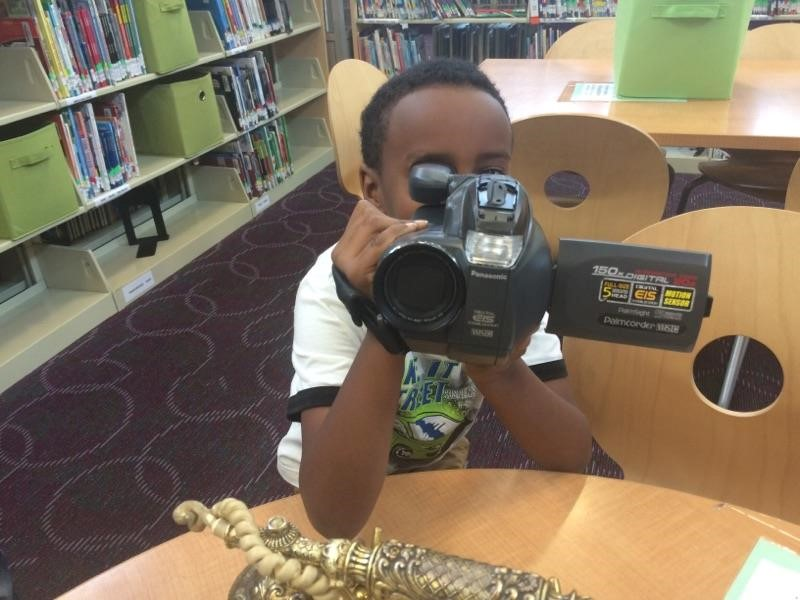 photo of student looking at camera through the lens of a VCR camera.