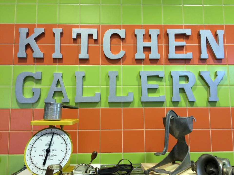 photo of the kitchen gallery sign posted on cafeteria wall.
