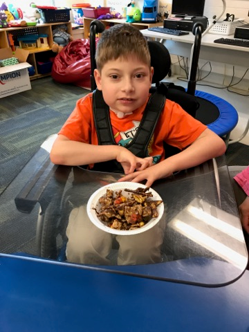 student with trail mix
