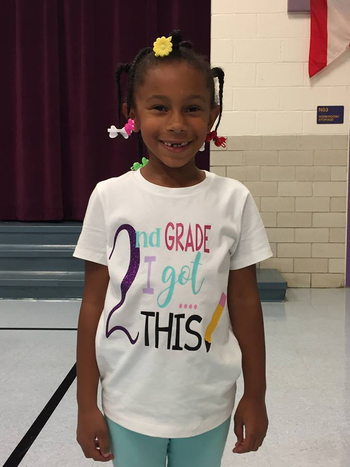 Student with second grade shirt on