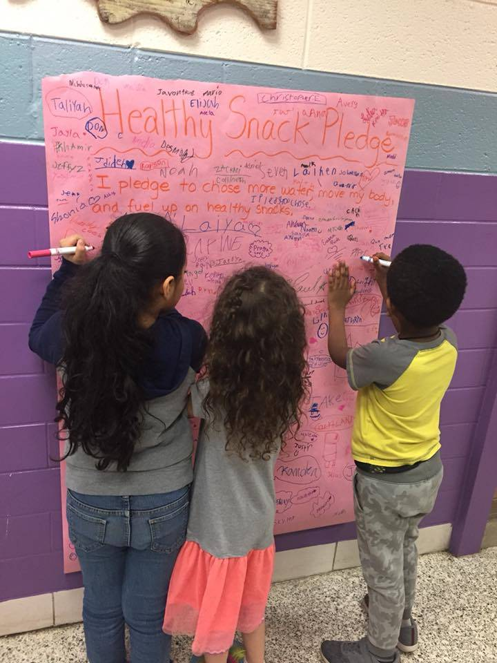 kids signing a pledge