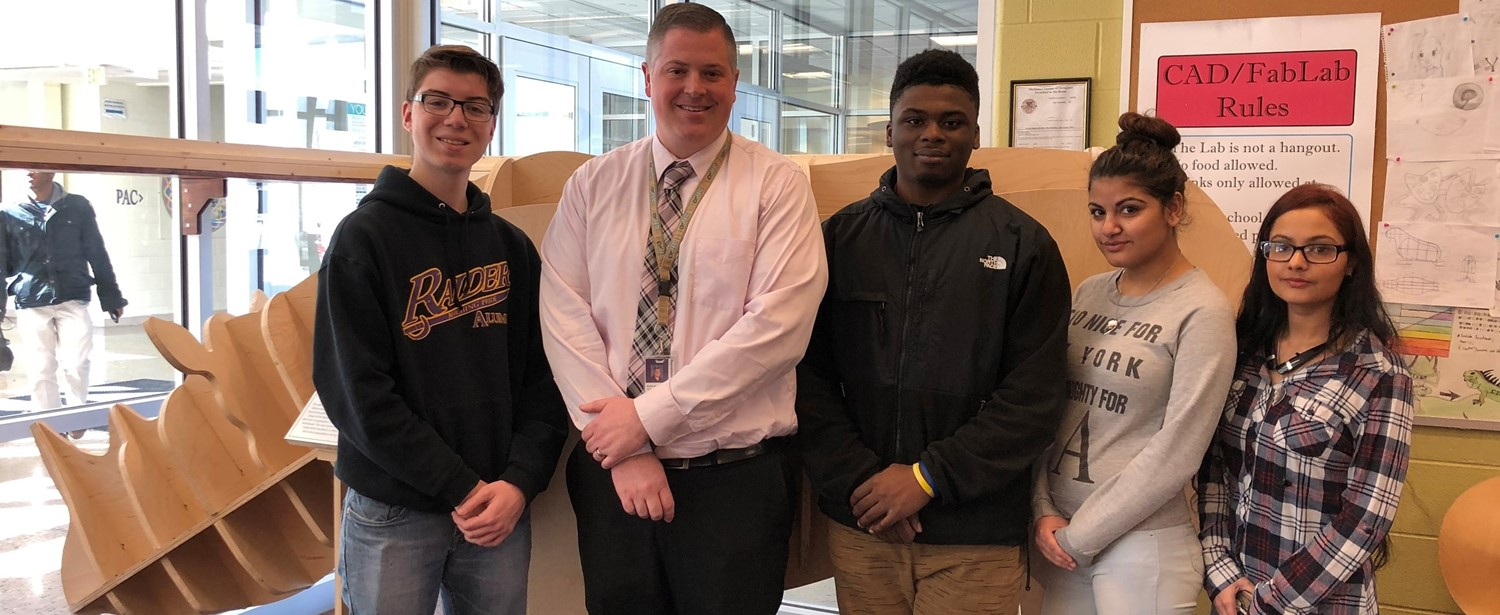 Mr. Bennett with eSTEM Students