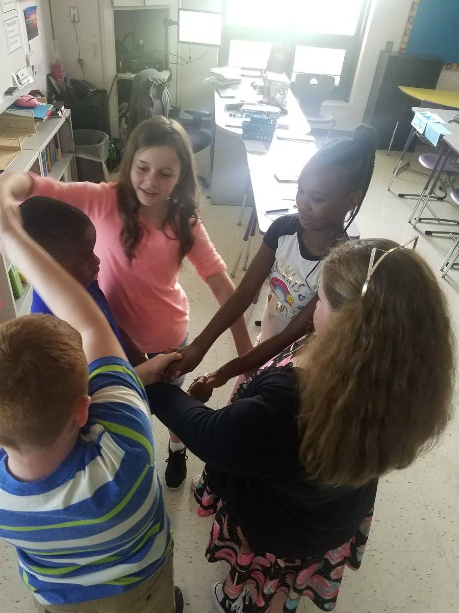 Untangling human knots to build a supportive and unified community.