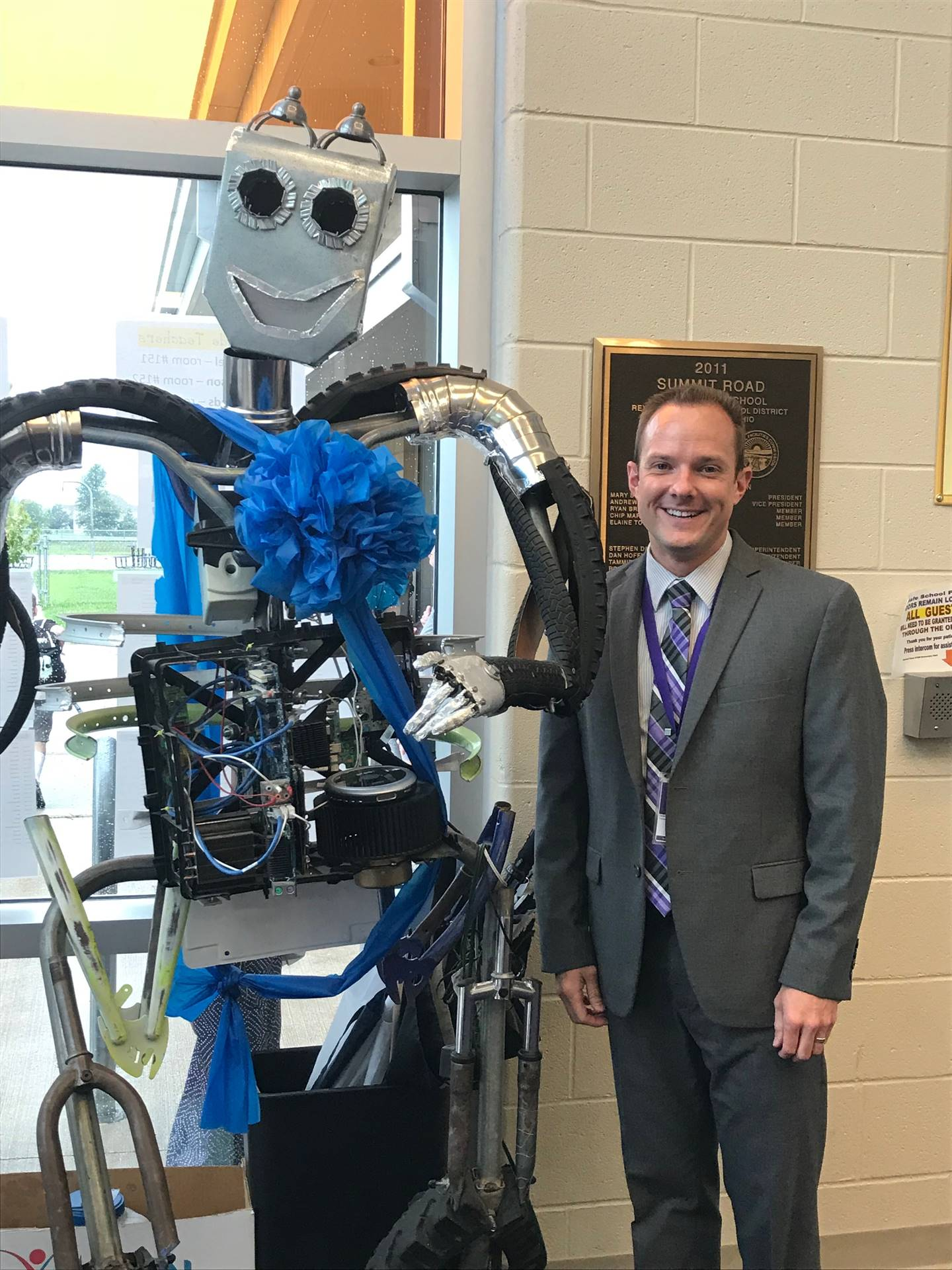 Photo of Principal with Sparky the robot