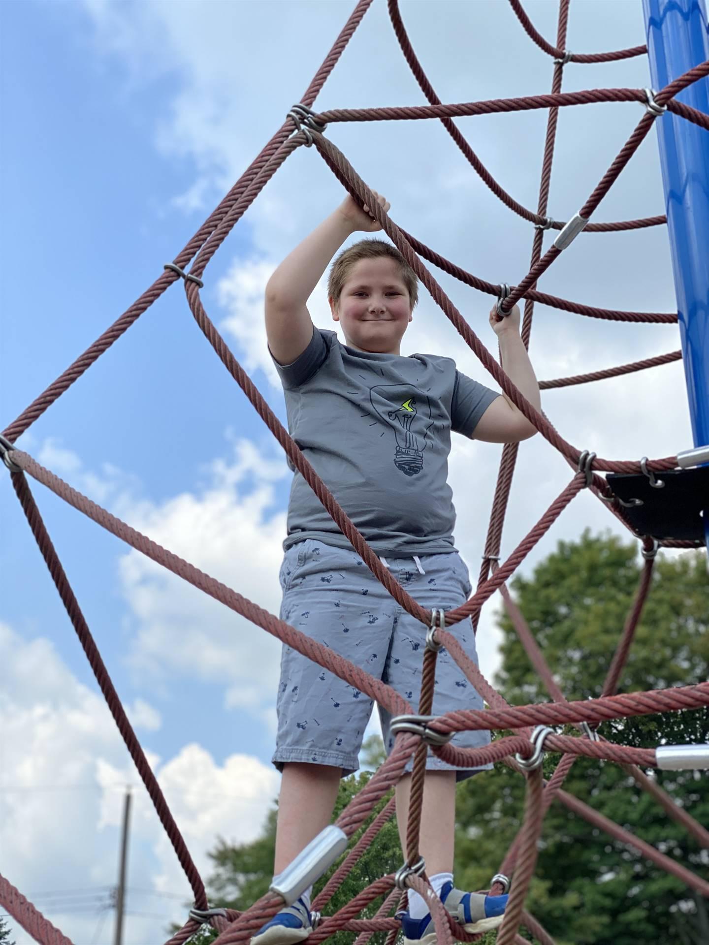 Student on playground equipment.