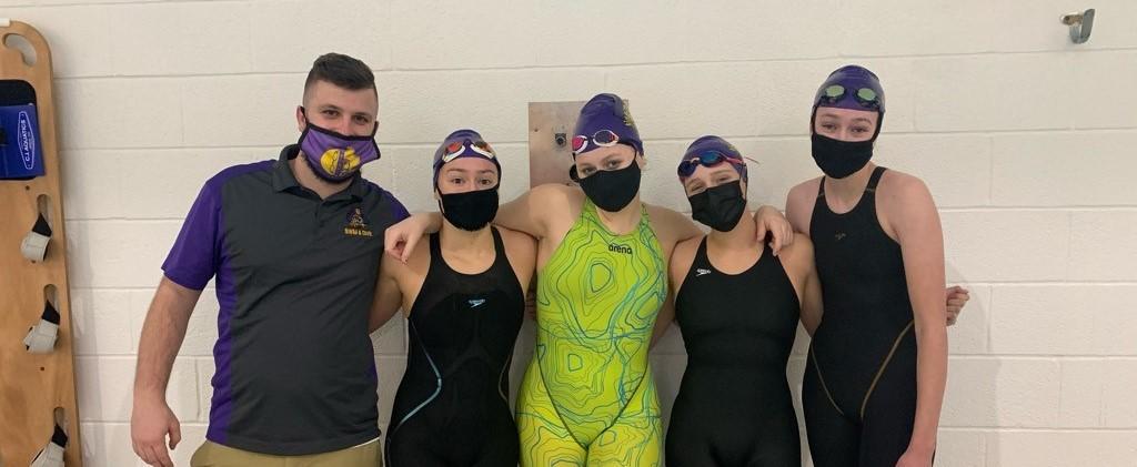 Girls Swim Team with Coach Dorsett