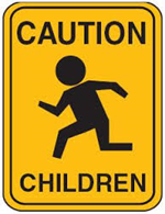 "street sign stating ""caution children"""