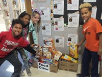Brayden and classmates donating food items to the Reynoldsburg Helping Hands Food Pantry