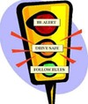 "traffic light with ""Be Alert, Drive Safe, Follow the Rules"""